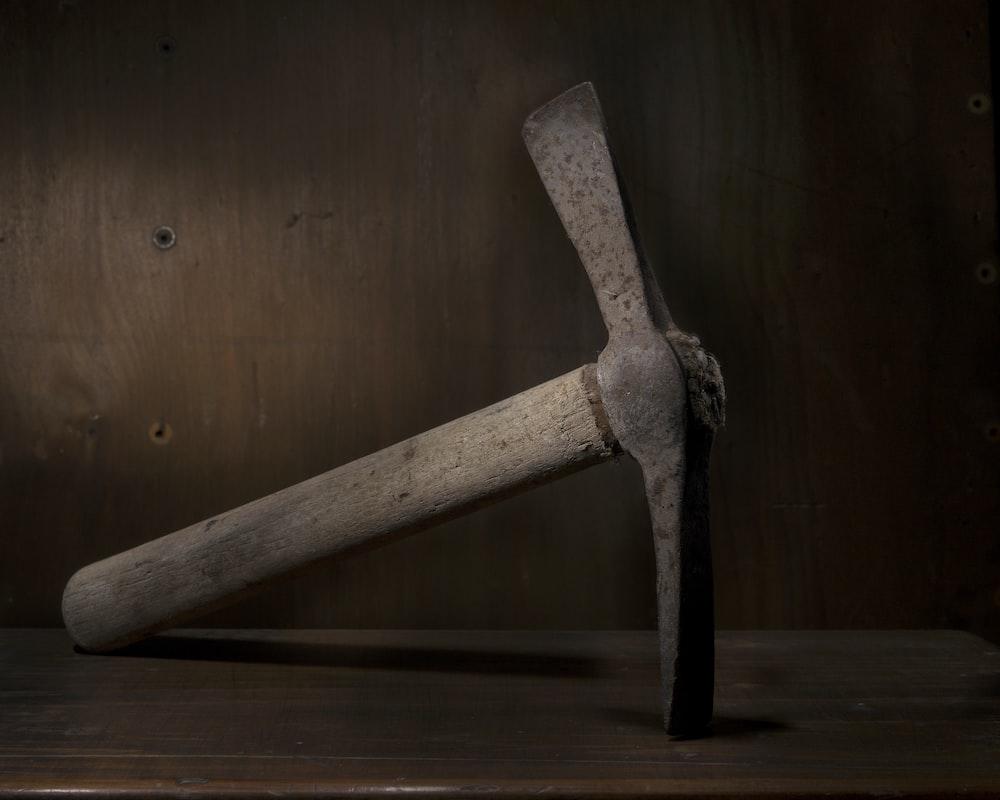 brown wooden handled pickax