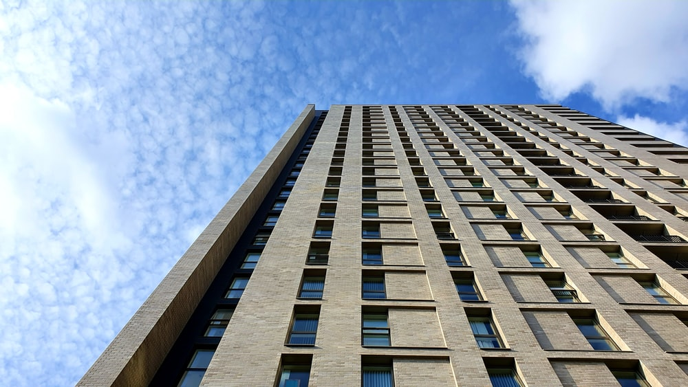 low-angle photography of brown high-rise building