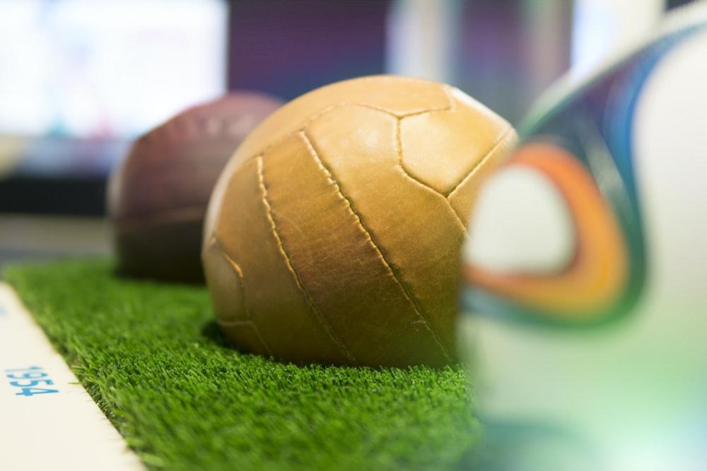 brown soccer ball on grass