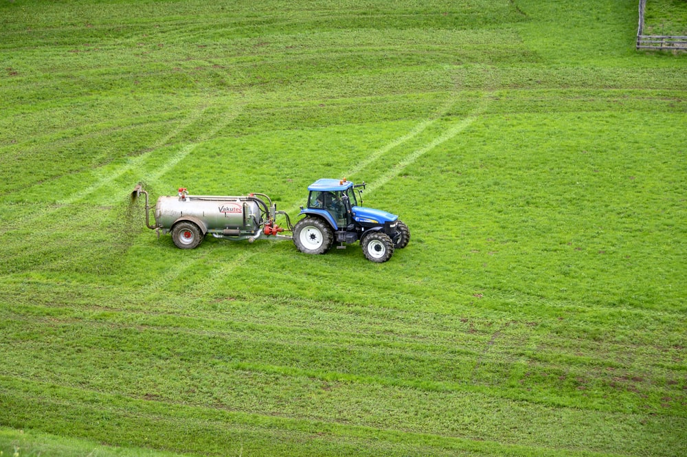 brown tractor on green grass field