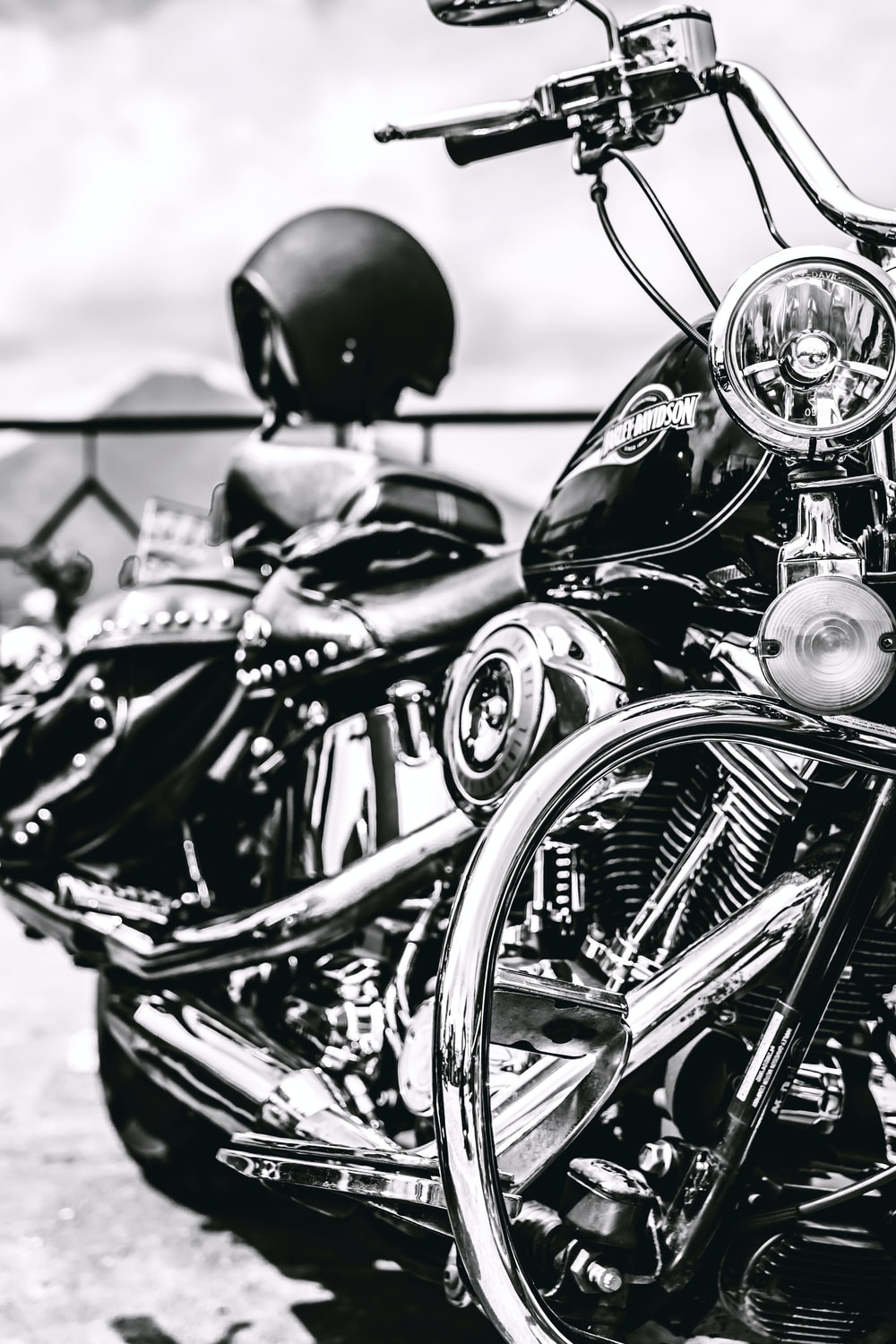 black motorcycle in grayscale photo