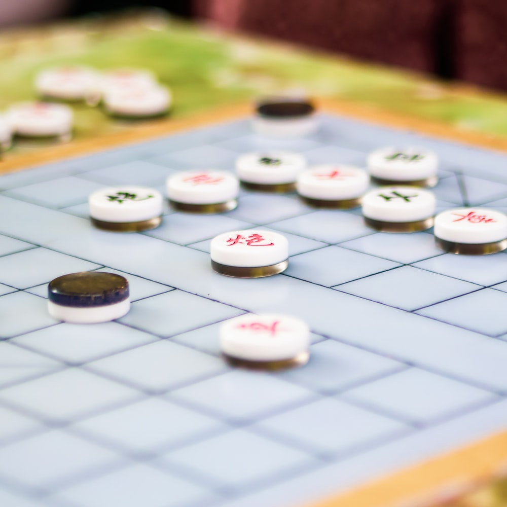 blue and brown Go board game