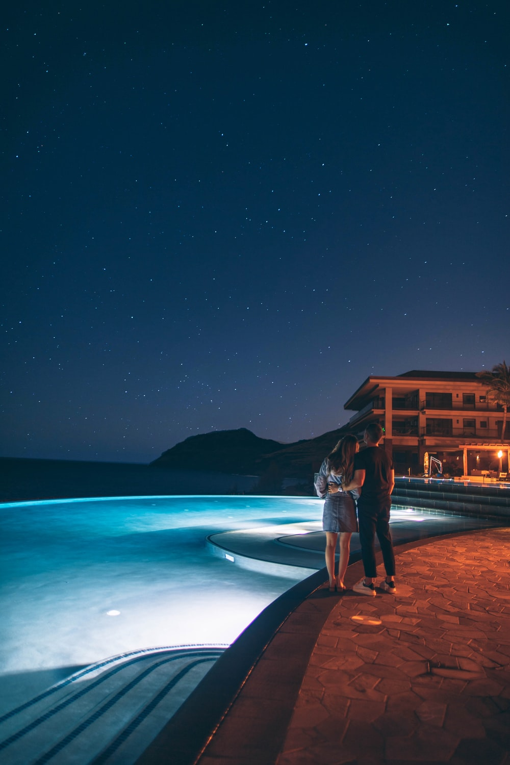 man and woman standing near pool