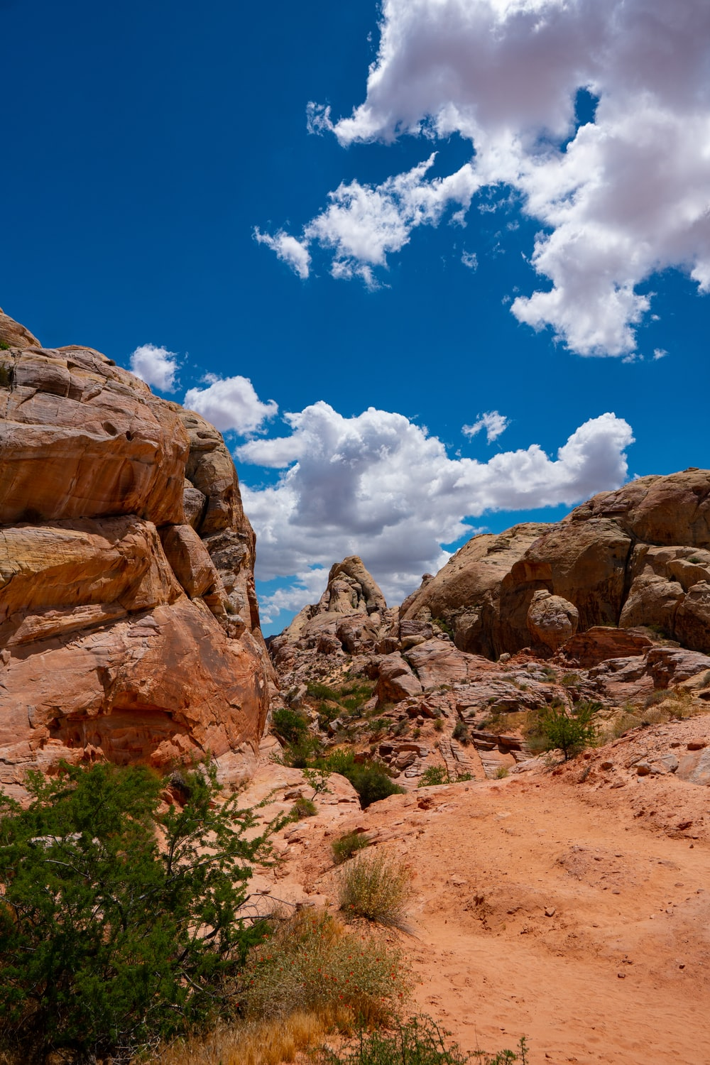 brown rock formations under white and blue skies