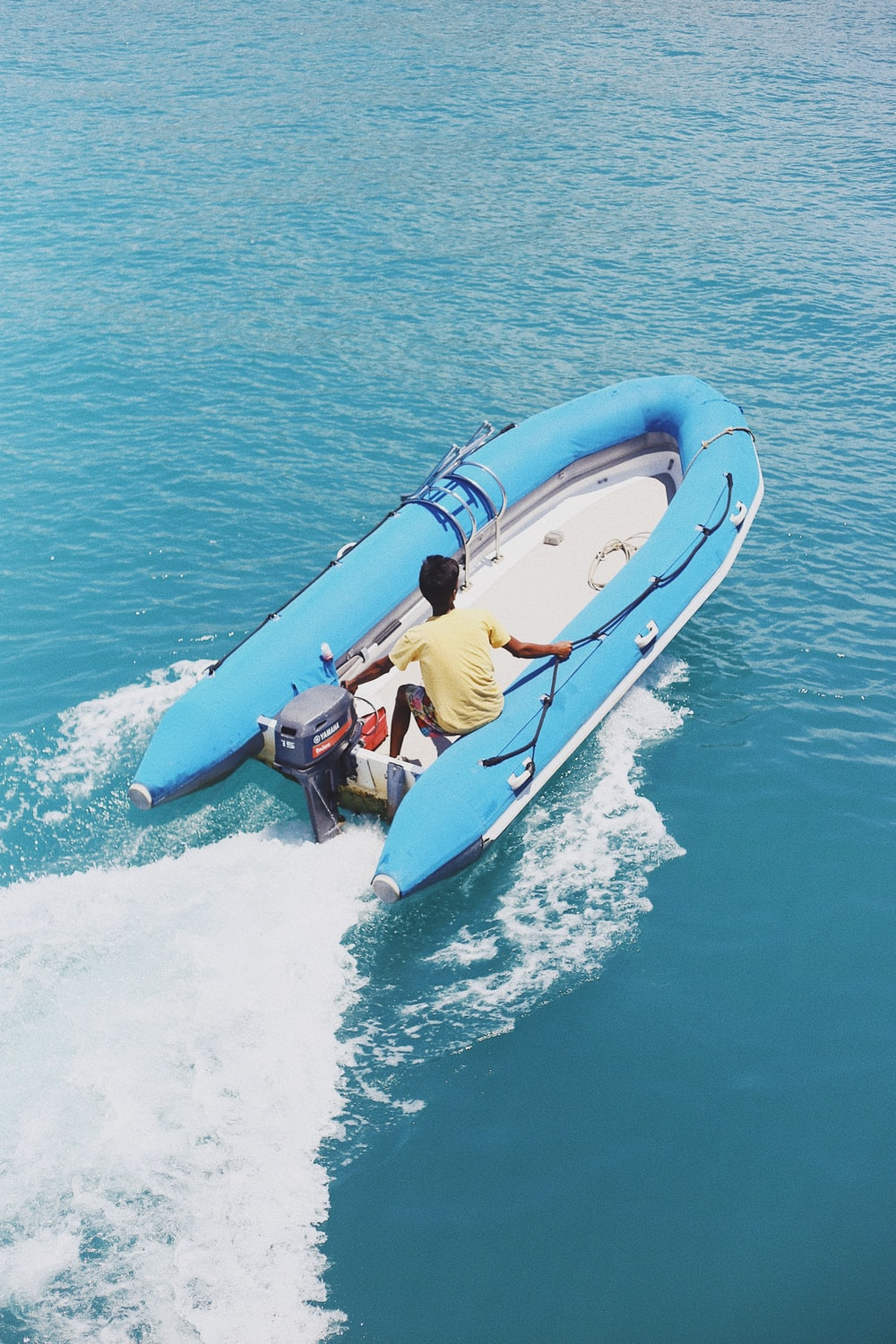 man riding inflatable powerboat