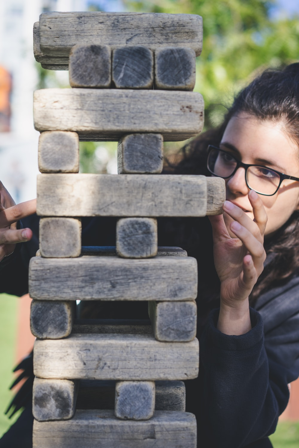 woman playing with wooden blocks