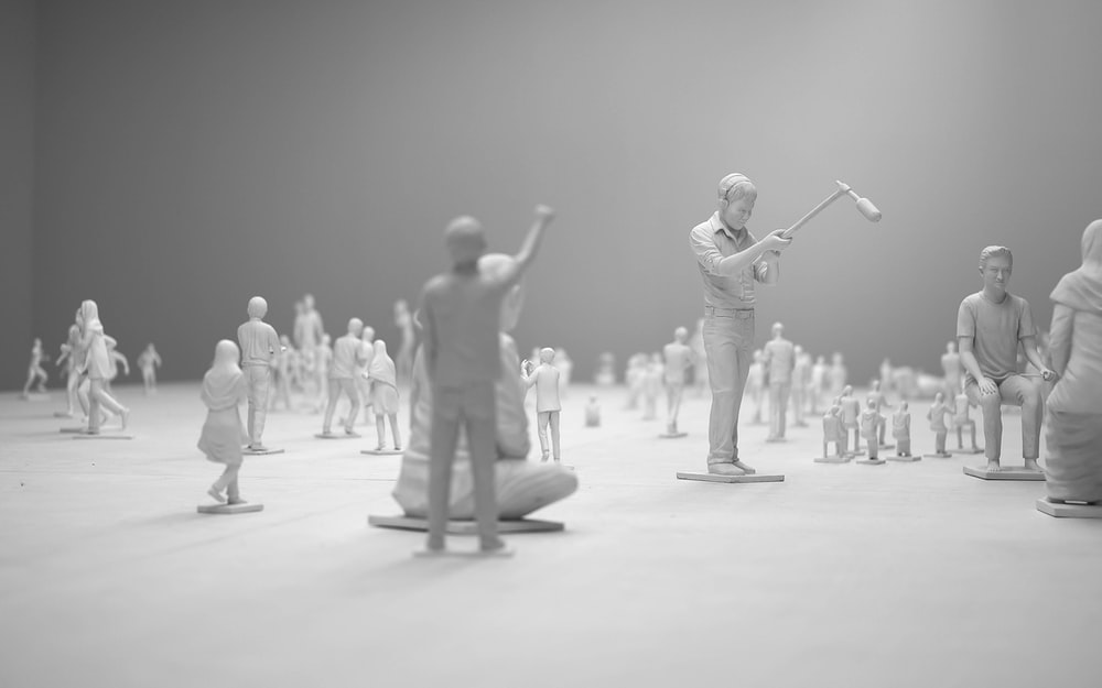 people figurines on white surface