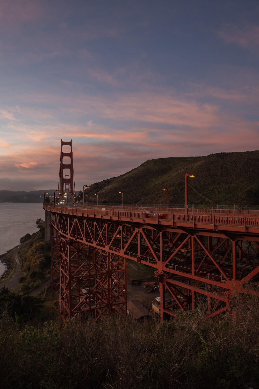 red metal bridge during golden hour