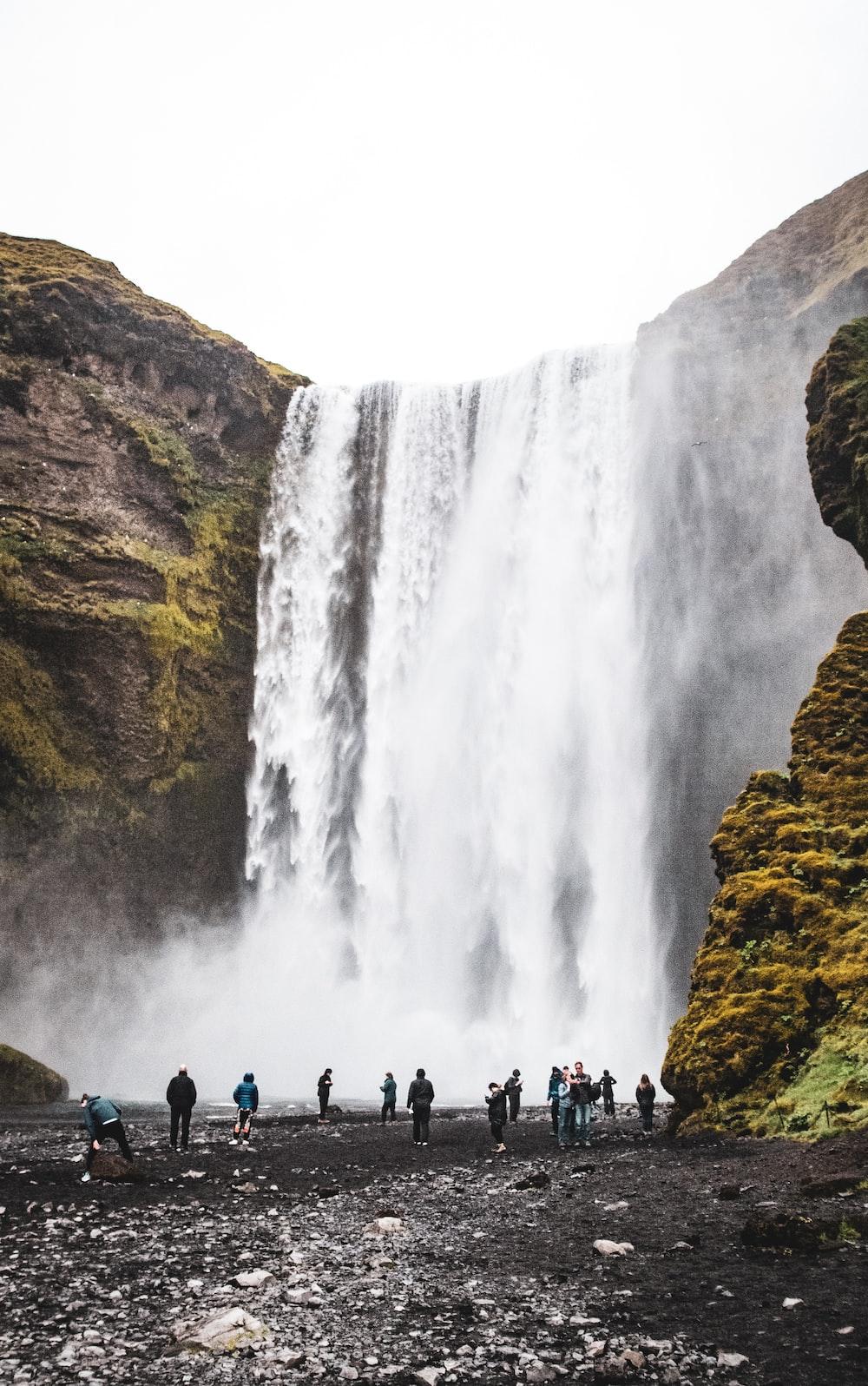 people watching waterfalls during daytime