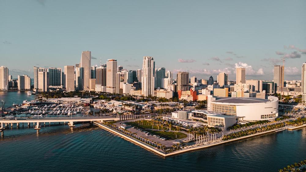 city skyline between sky and body of water