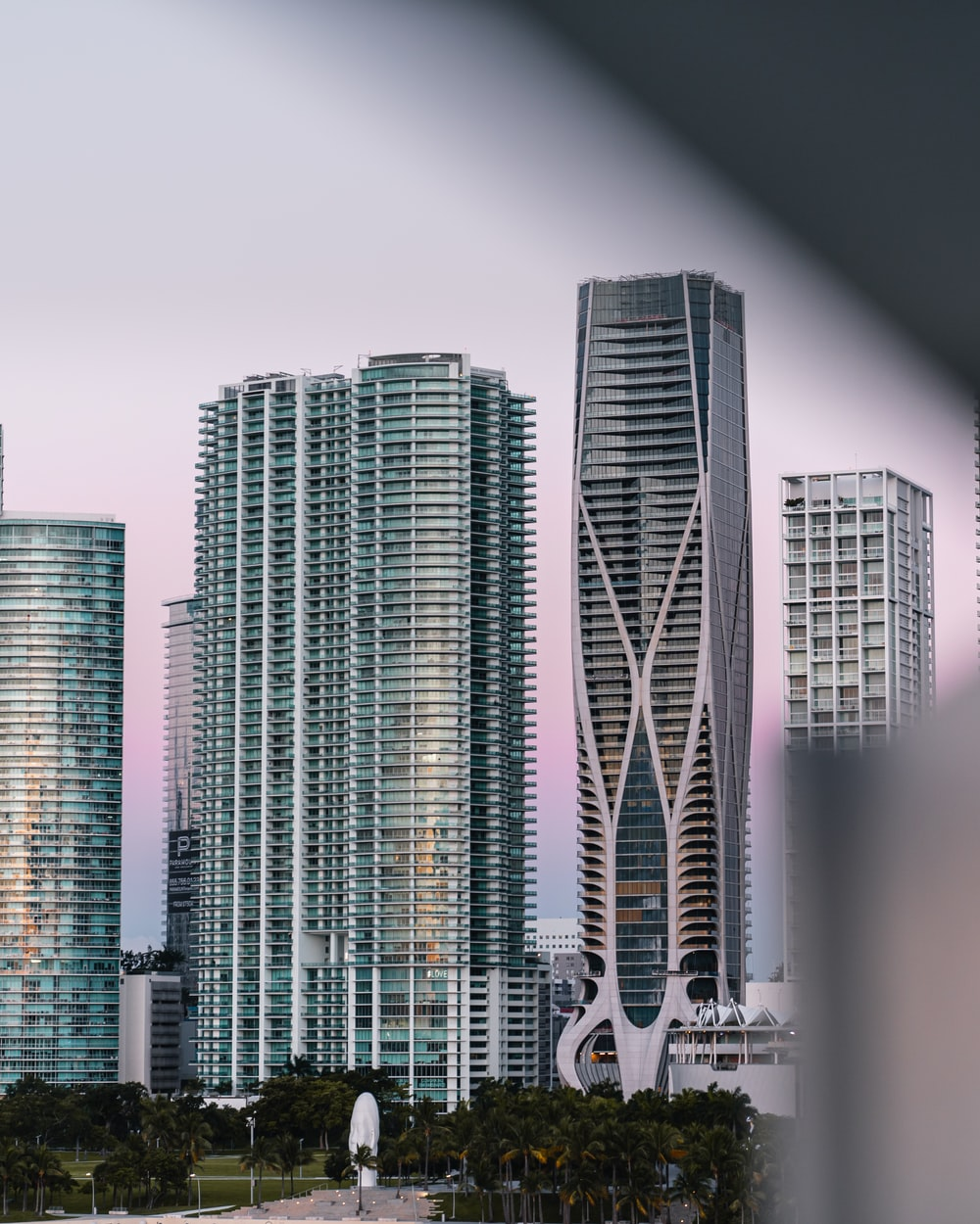 high rise buildings near trees
