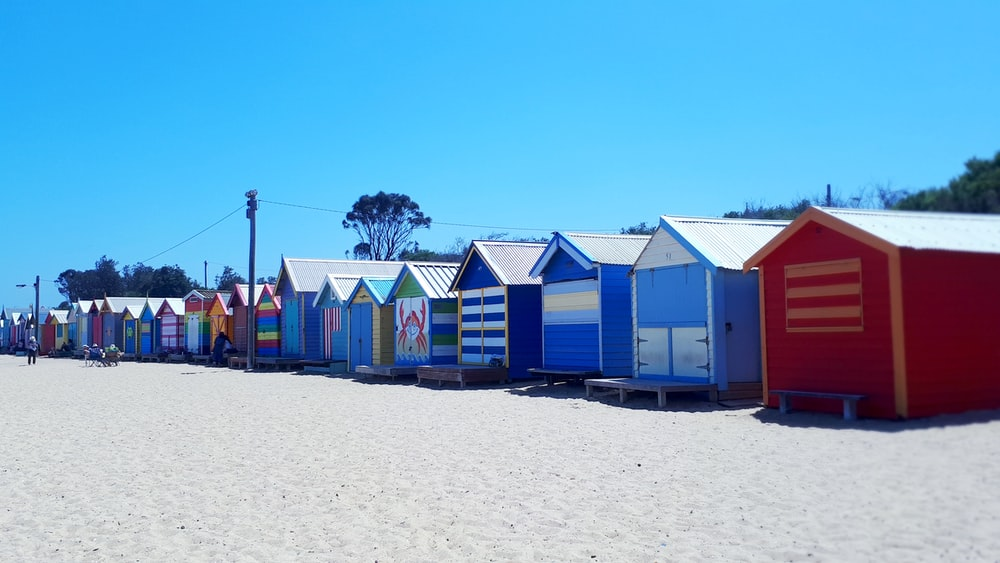 multicolored wooden houses near beach