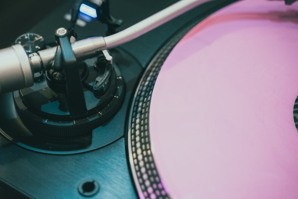 grey and pink vinyl turntable