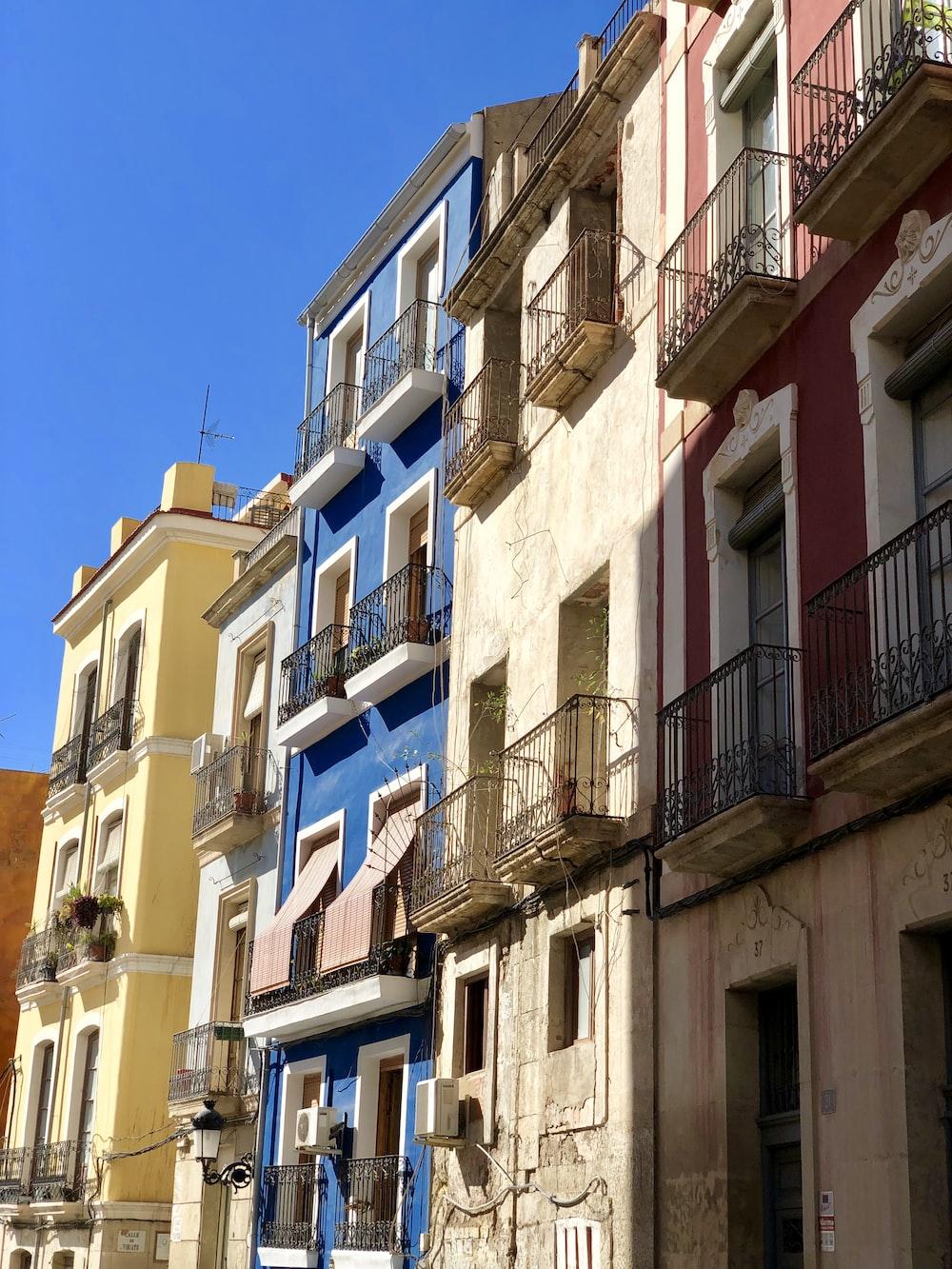 five assorted-color concrete buildings