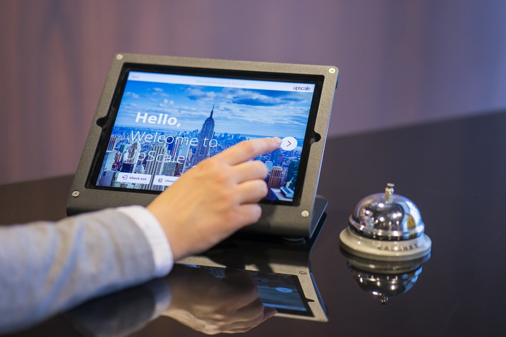 person about to touch black Android tablet computer
