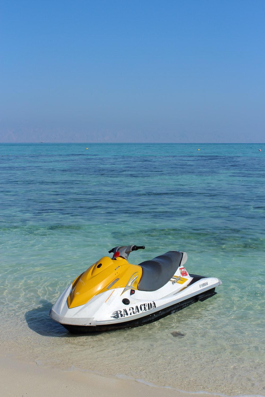 white and yellow personal watercraft
