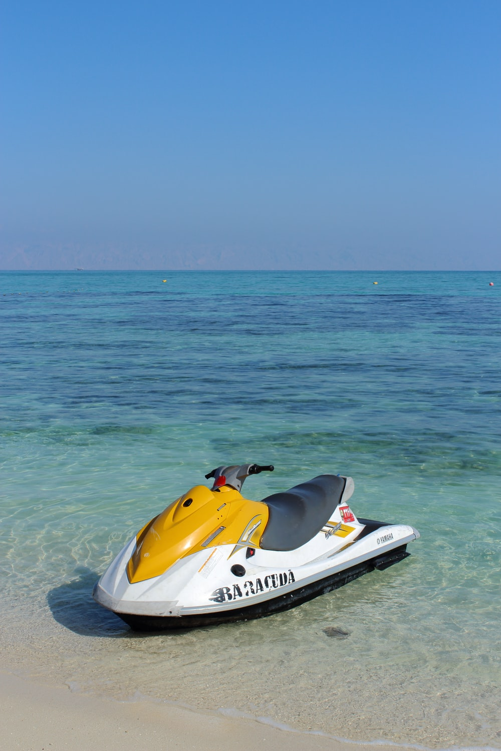 white and yellow personal watercraft