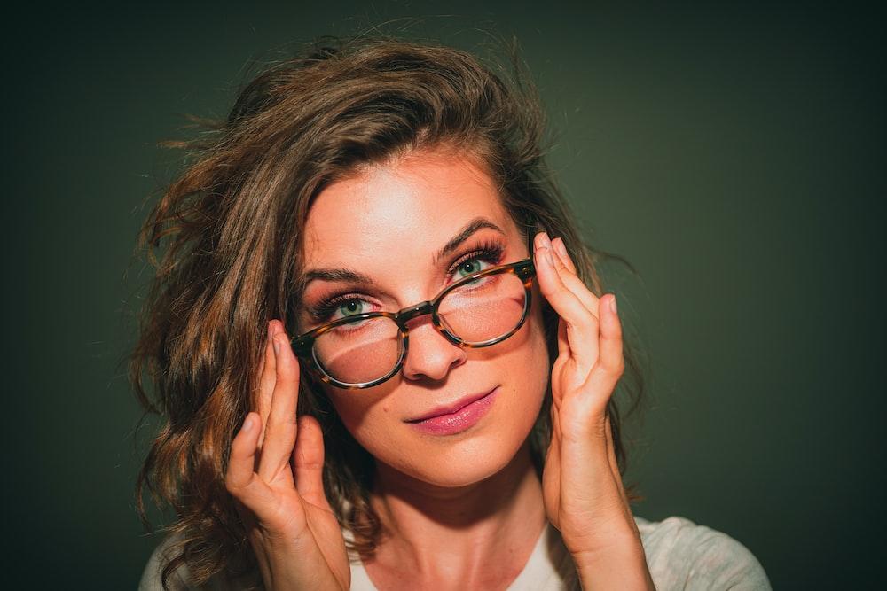 portrait of woman wearing eyeglasses with black frames