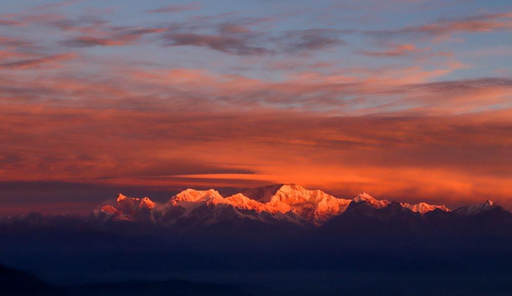 snowy mountain under indigo sky