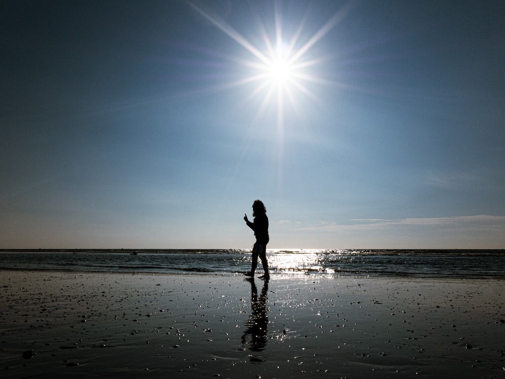person standing on the seashore