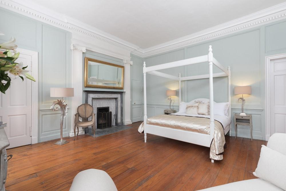 white canopy bed inside bedroom