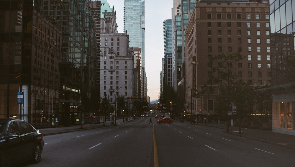 city buildings and gray pavement road