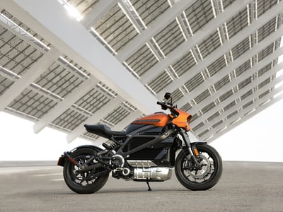 black and orange motorcycle
