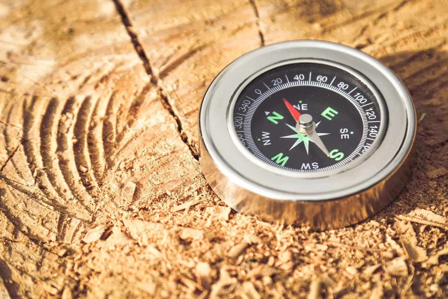 compass in a wooden surface