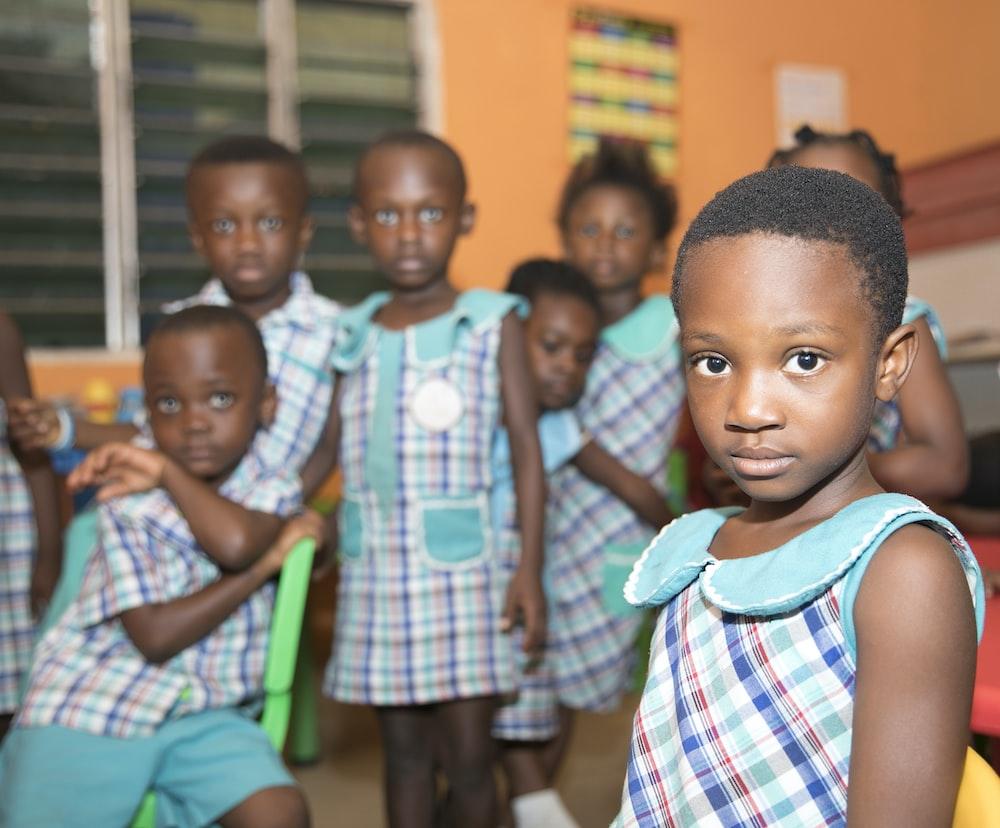 children standing near window