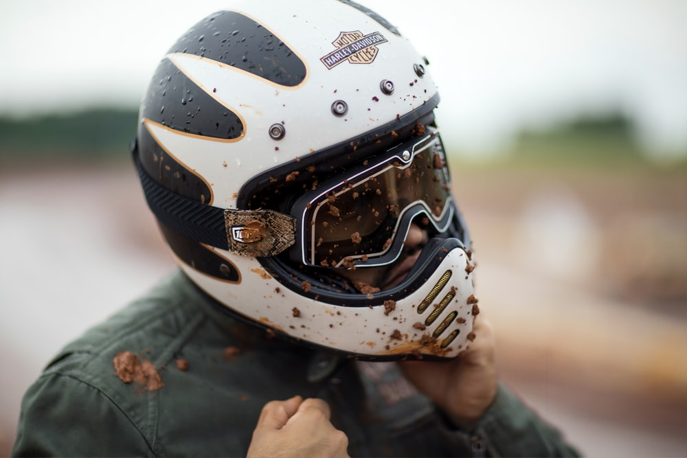 person wearing white and black helmet
