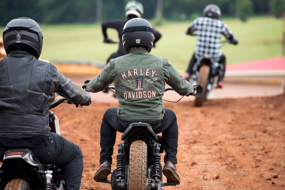 four men riding motocross dirt bikes