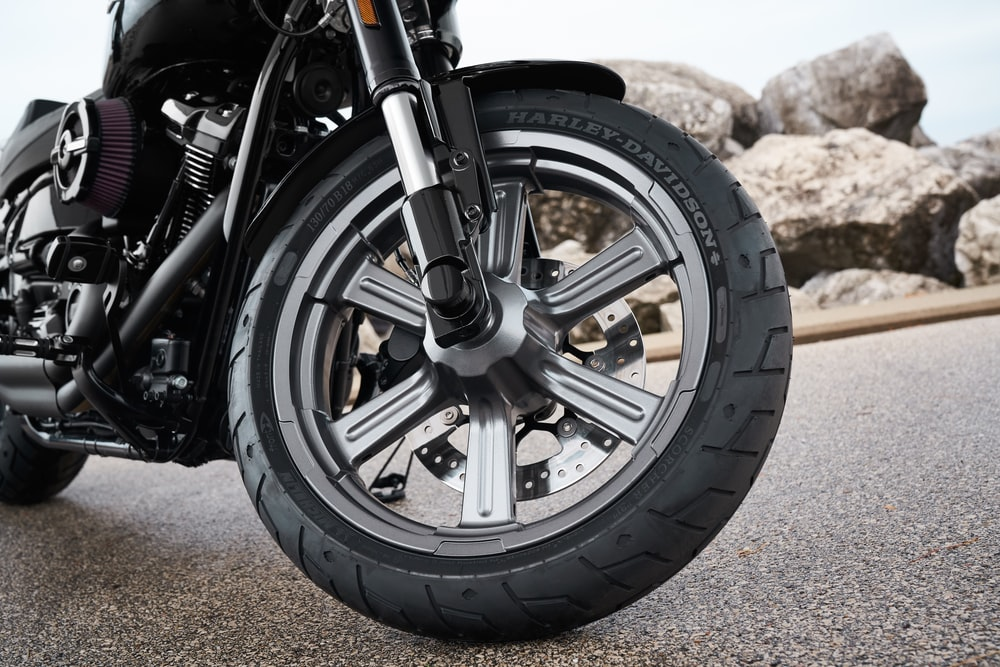 closeup photography of black motorcycle