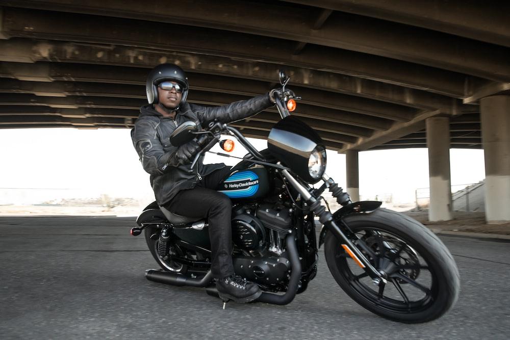 man riding black motorcycle