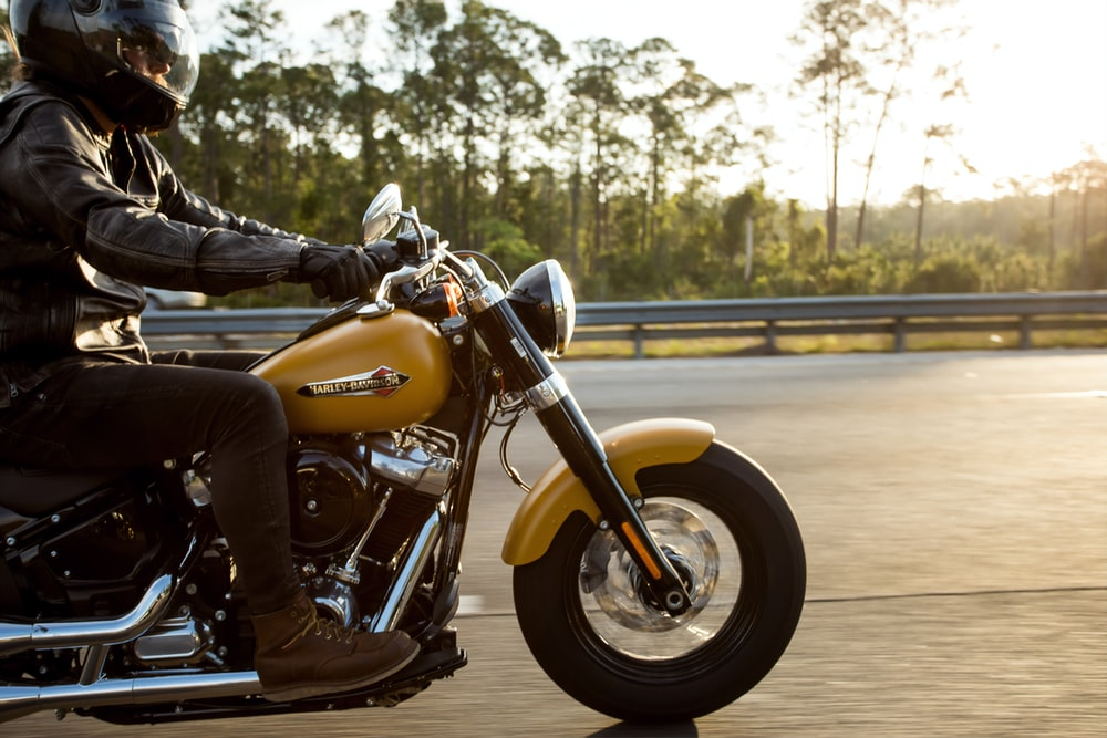 man riding motorcycle photography
