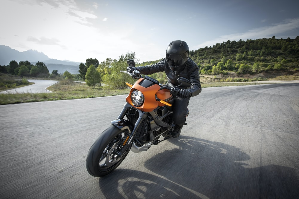 person driving orange motorcycle