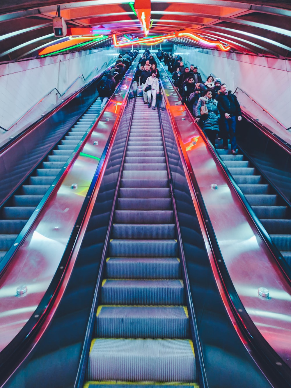 people on escalator going down