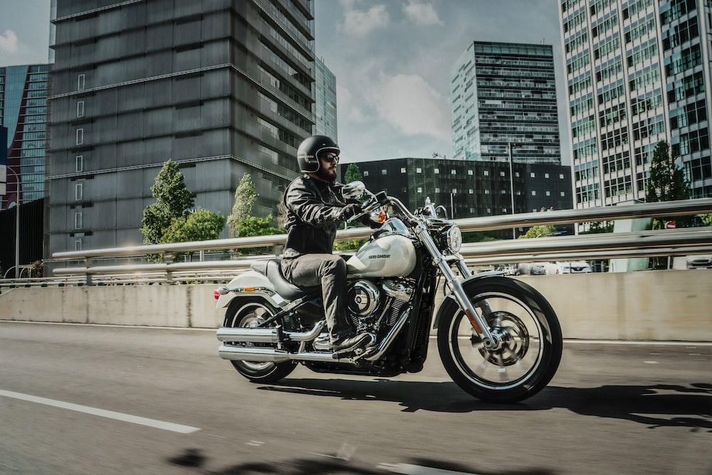 man riding cruiser motorcycle