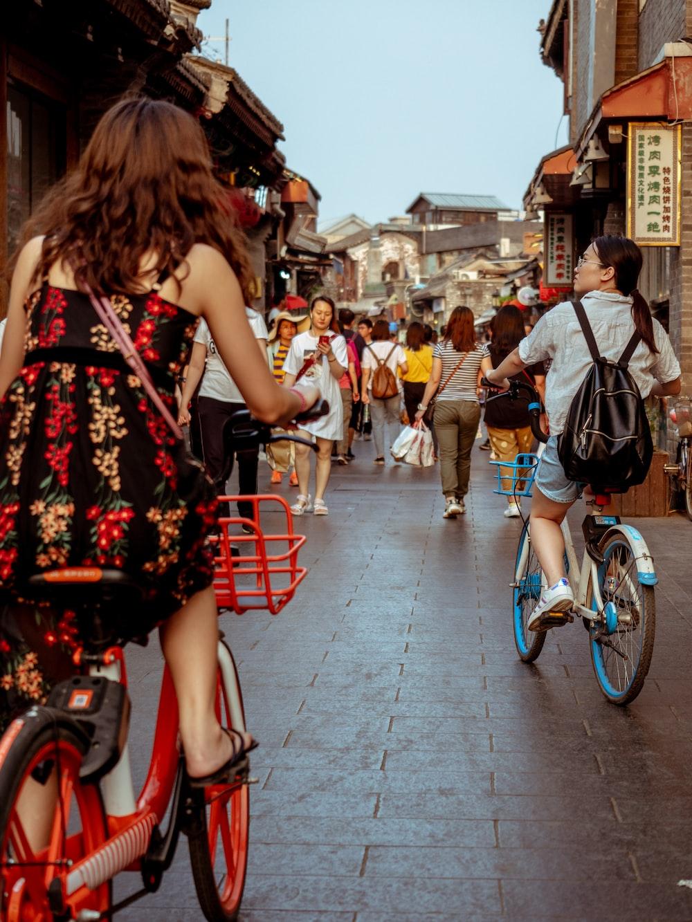 woman wearing dress riding bicycle