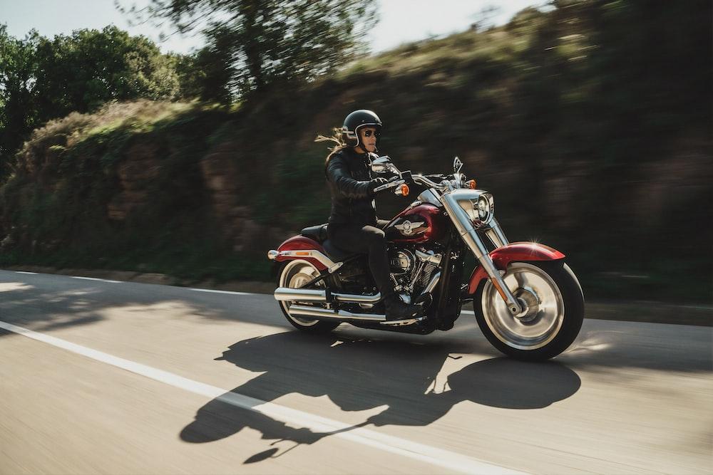 man on red cruiser motorcycle i