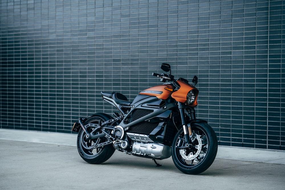 black and orange motorcycle