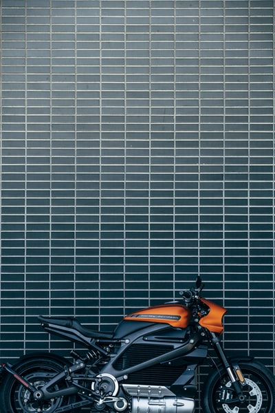 orange and black motorcycle