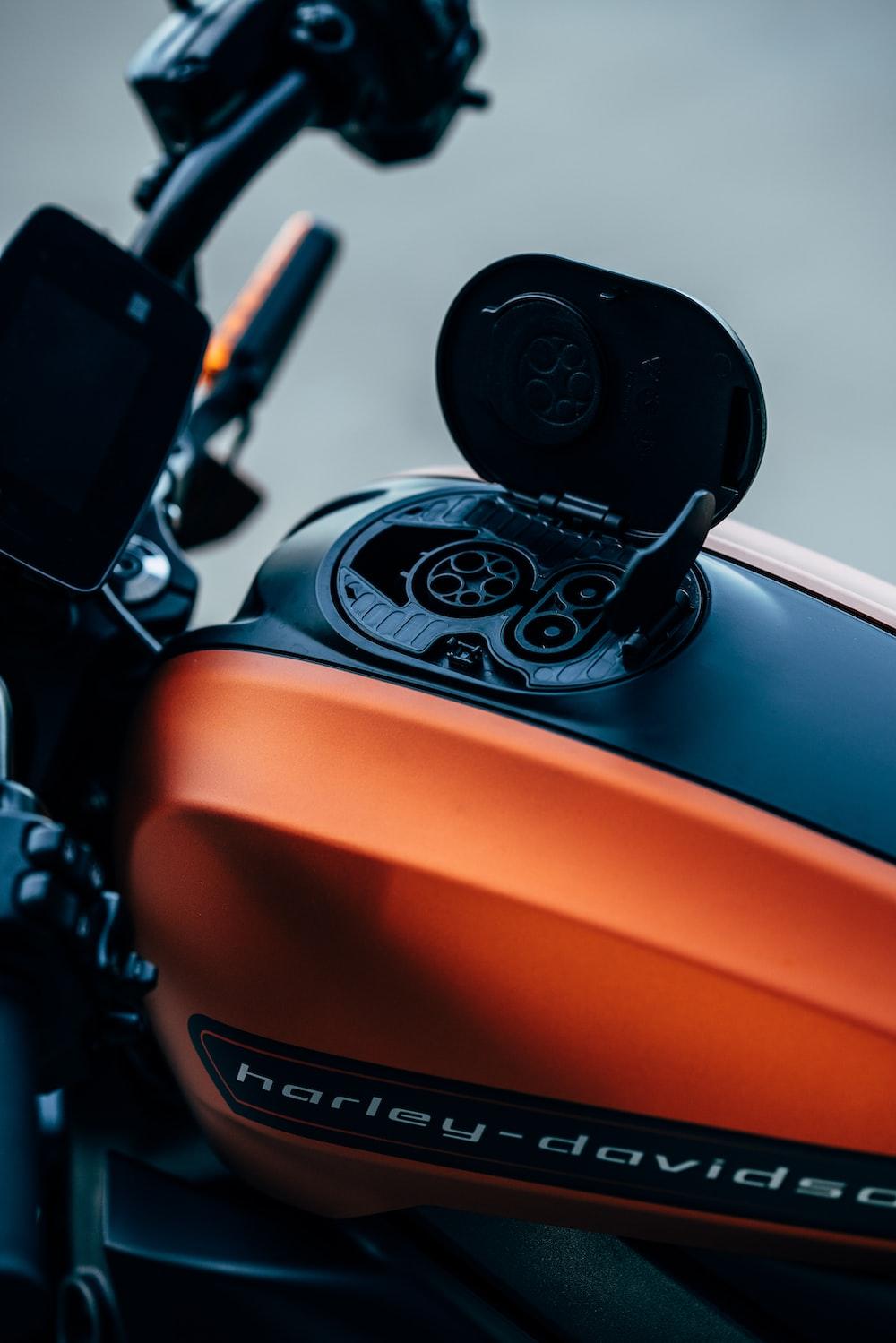 orange and black Harley-Davidson motorcycle