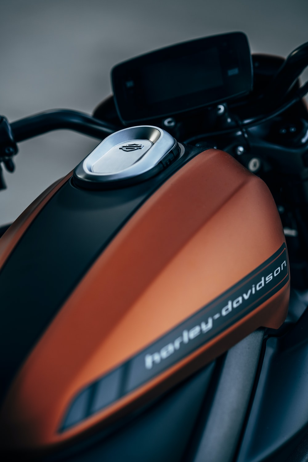 orange and black Harley-Davidson backbone motorcycle