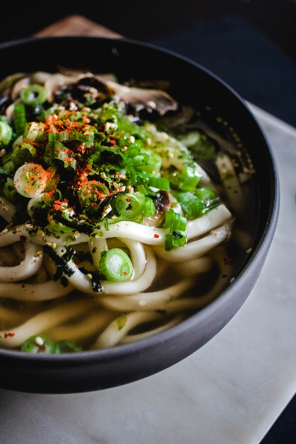 noodle soup on black bowl
