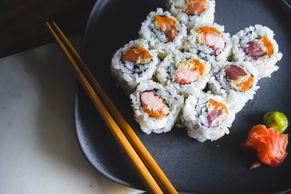 sushi food with brown wooden chopsticks