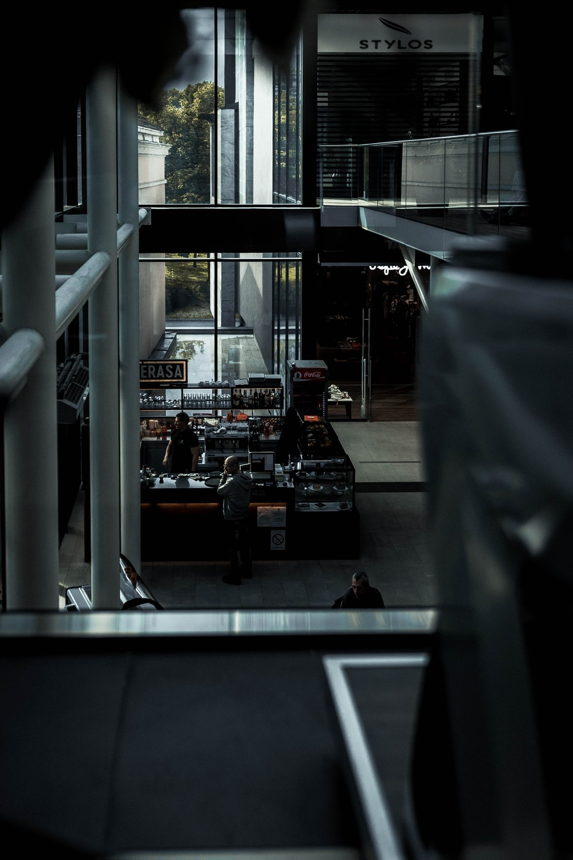 people in coffee bar in building ground floor