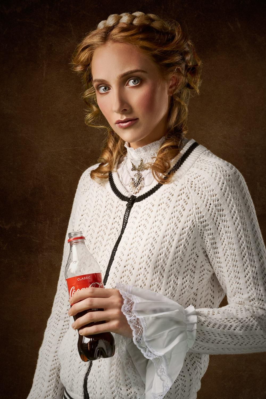 woman holding Coke bottle