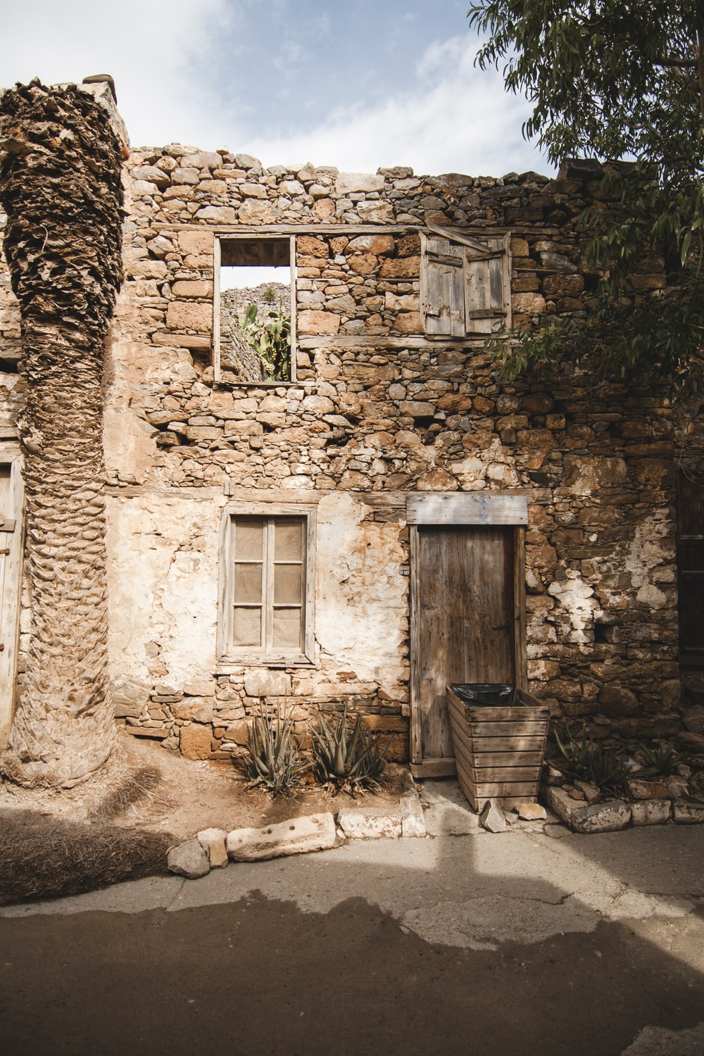 closed door and window stone house