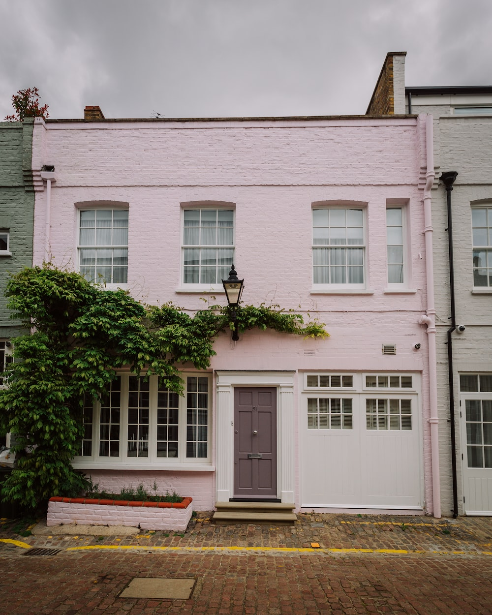 white and pink concrete house
