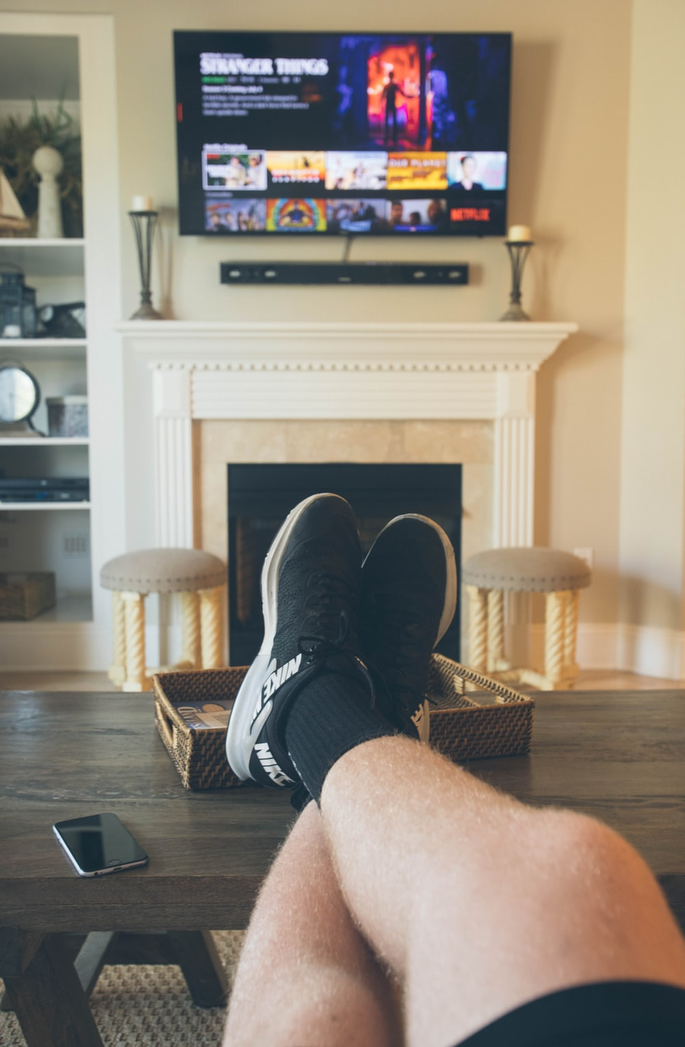 person wearing black shoes on seated near coffee table